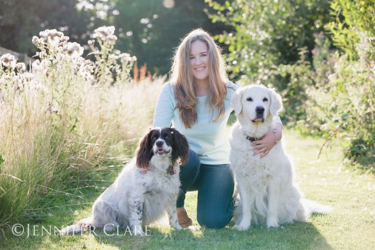 A teenager with her dogs, photographed on a sunny evening in a Derbyshire village