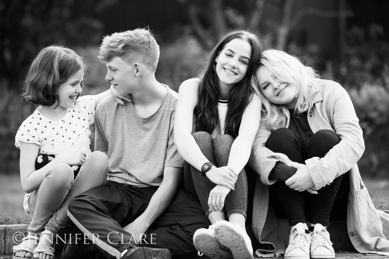 a family of teens in black and white, shot on location by photographer Duffield, Derbyshire.