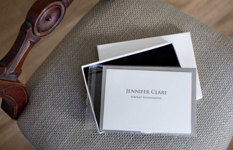 photography gift voucher pictured: an A6 landscape folded card with letterin on the front and a black an white image of a father and daughter on the inside, with room for a message to be written.