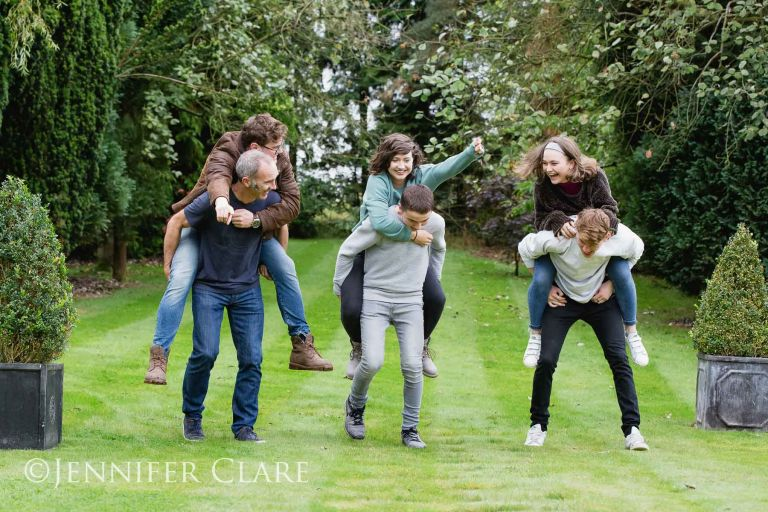 family session in derbyshire, with piggyback fun in the garden
