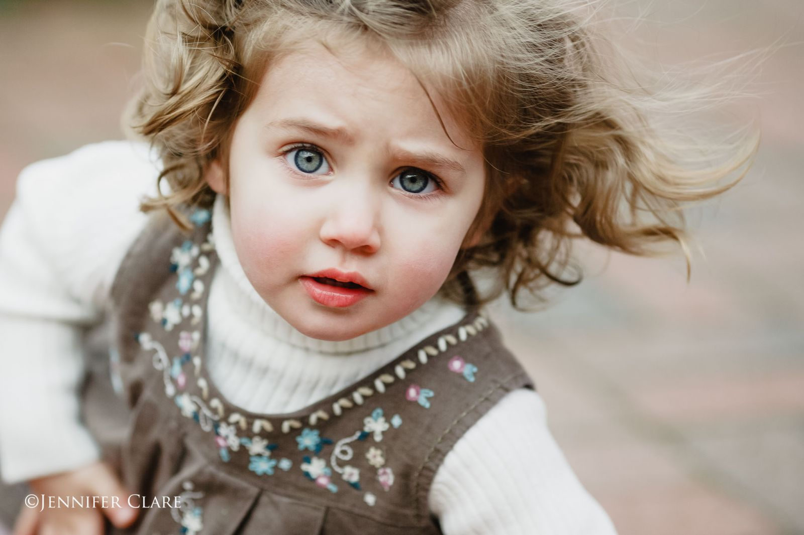 a colour image of a small girl with a quizzical expression.